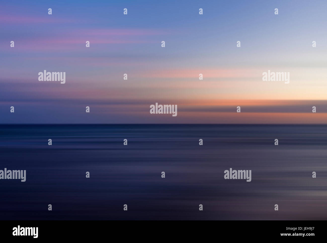 Beautiful colourful oceanscape lines during sunset in long exposure; Honolulu, Oahu, Hawaii, United States of America - Stock Image