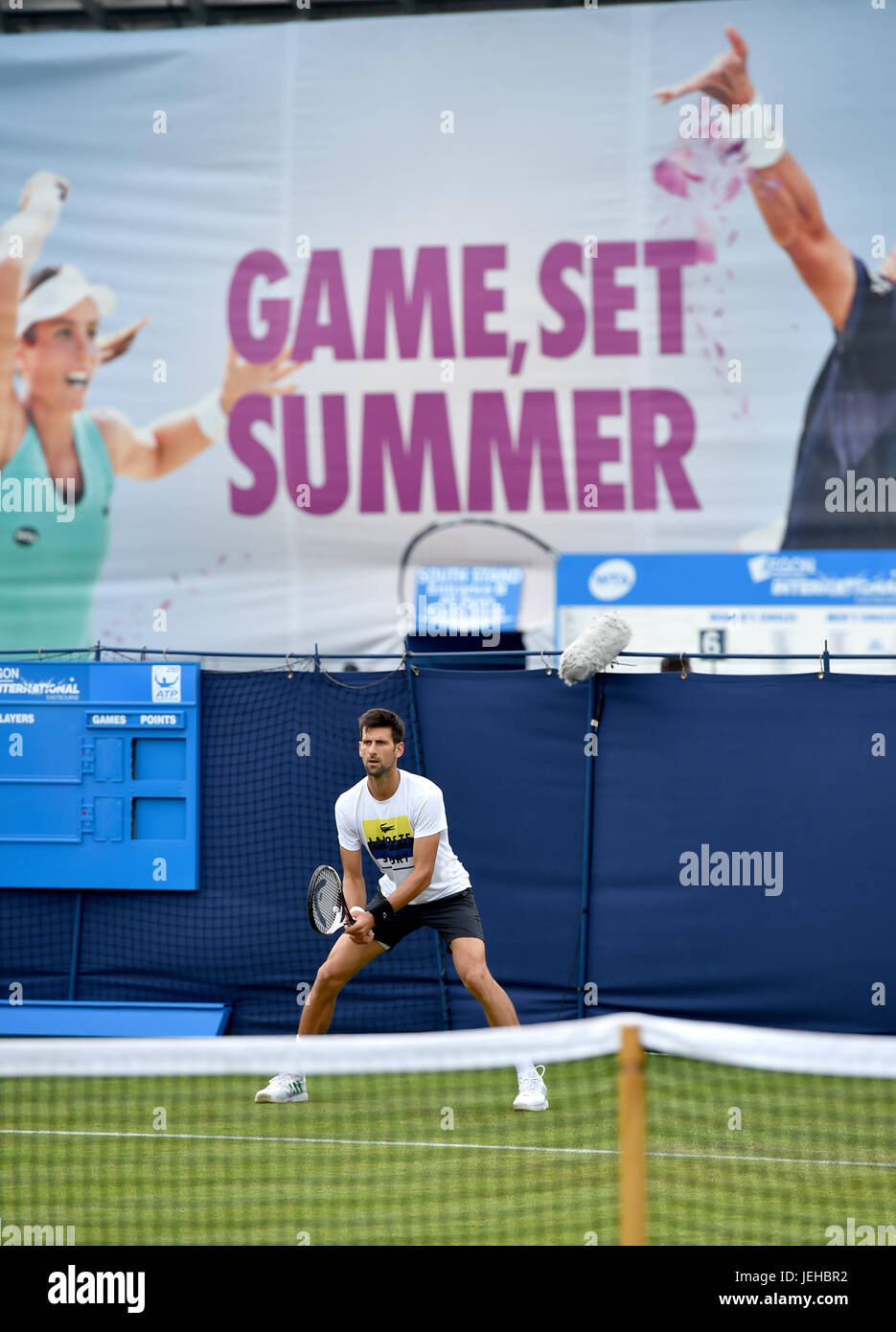 Novak Djokovic practicing at the Aegon International tennis tournament at Devonshire Park in Eastbourne East Sussex - Stock Image