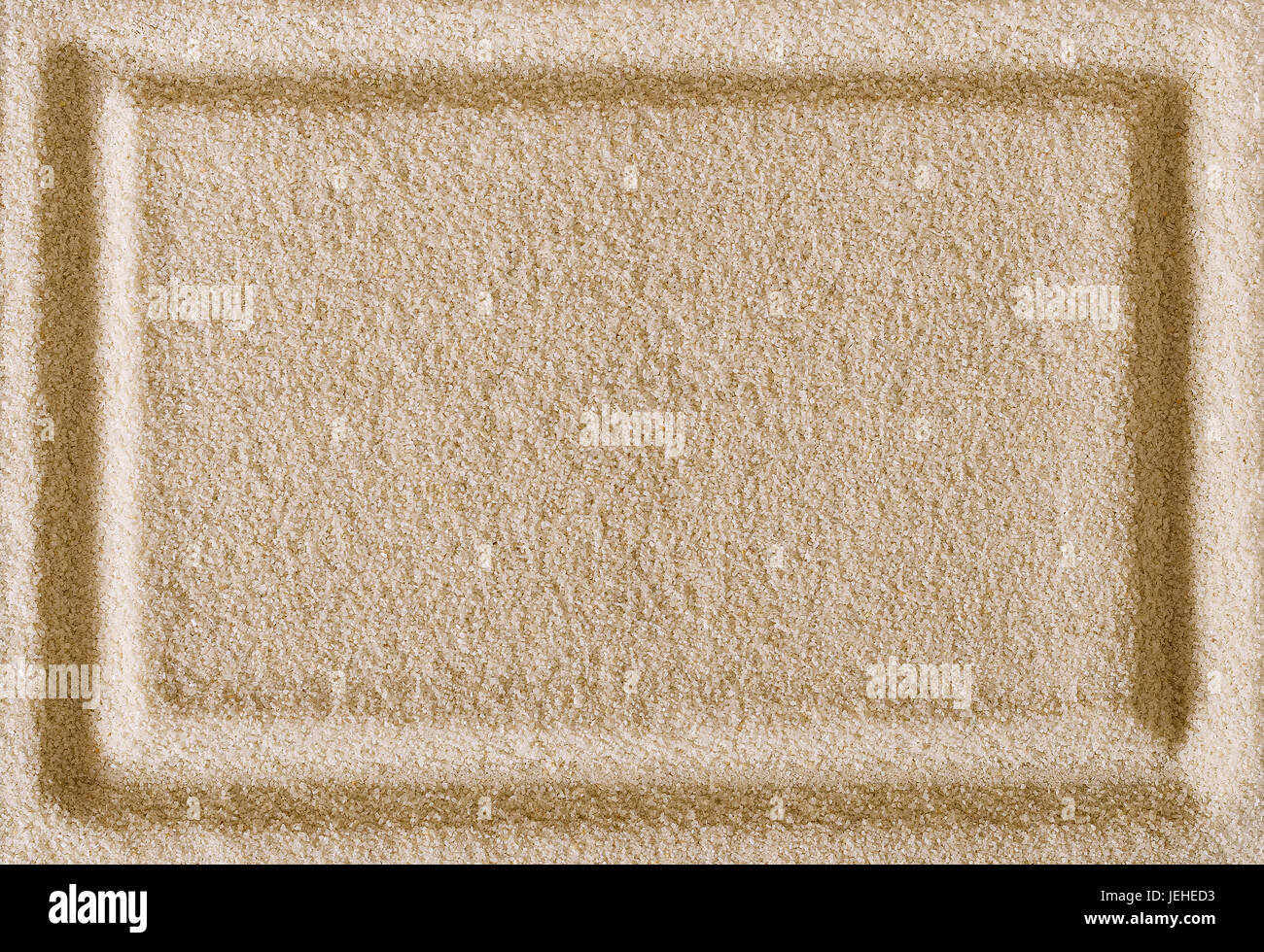 Rectangle shape imprint in sand surface. Rectangular border in a ...