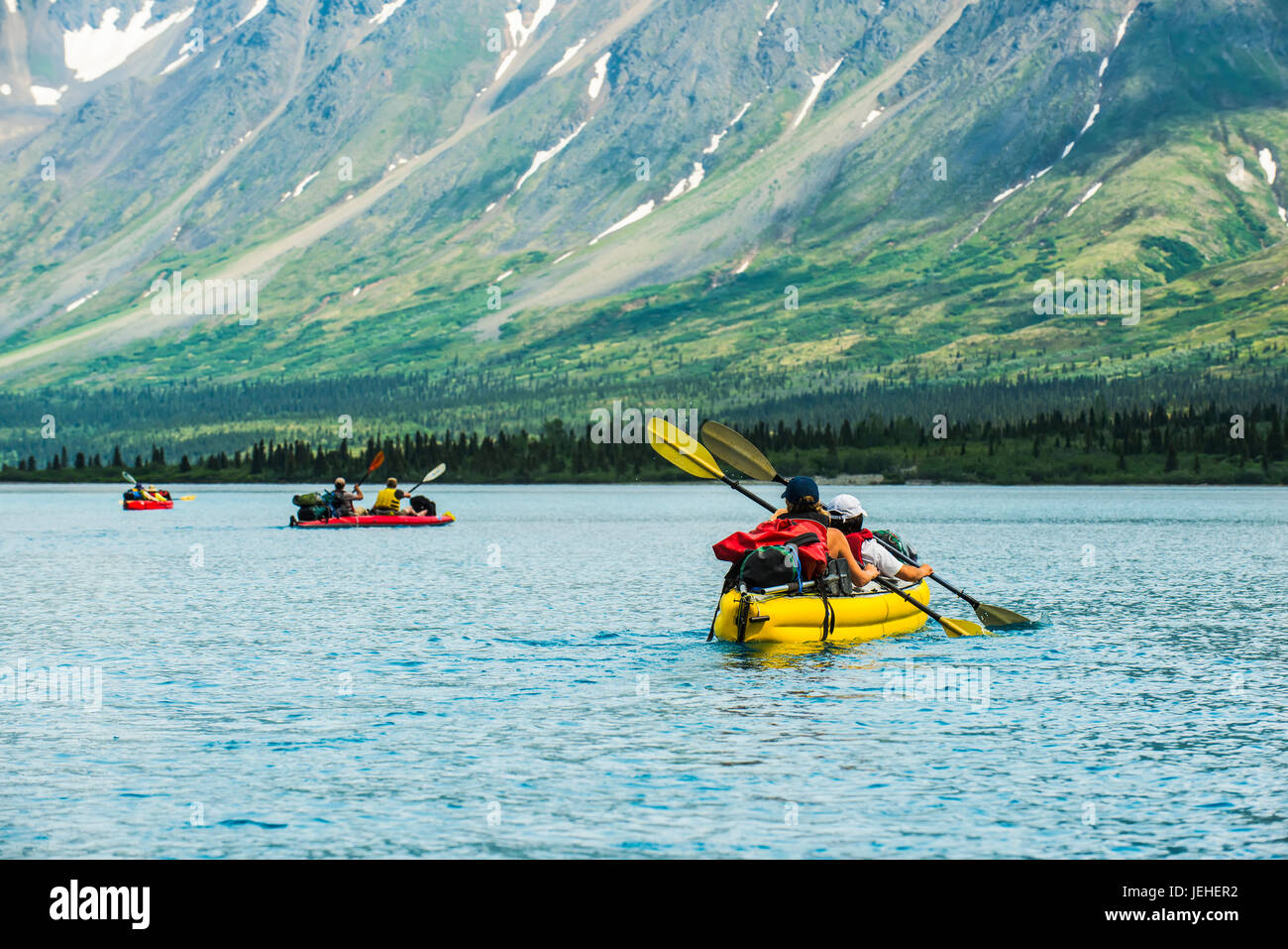 Group kayaking across Twin Lake in Lake Clark National Park and Preserve, Southcentral Alaska, USA - Stock Image