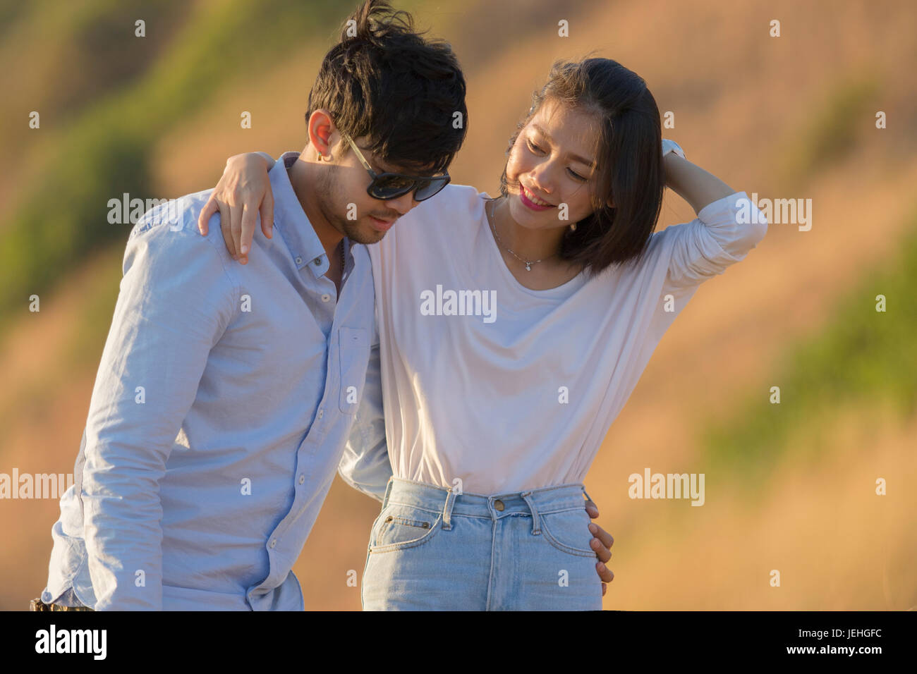 couples younger asian man and woman relaxing time on vacation destination traveling - Stock Image