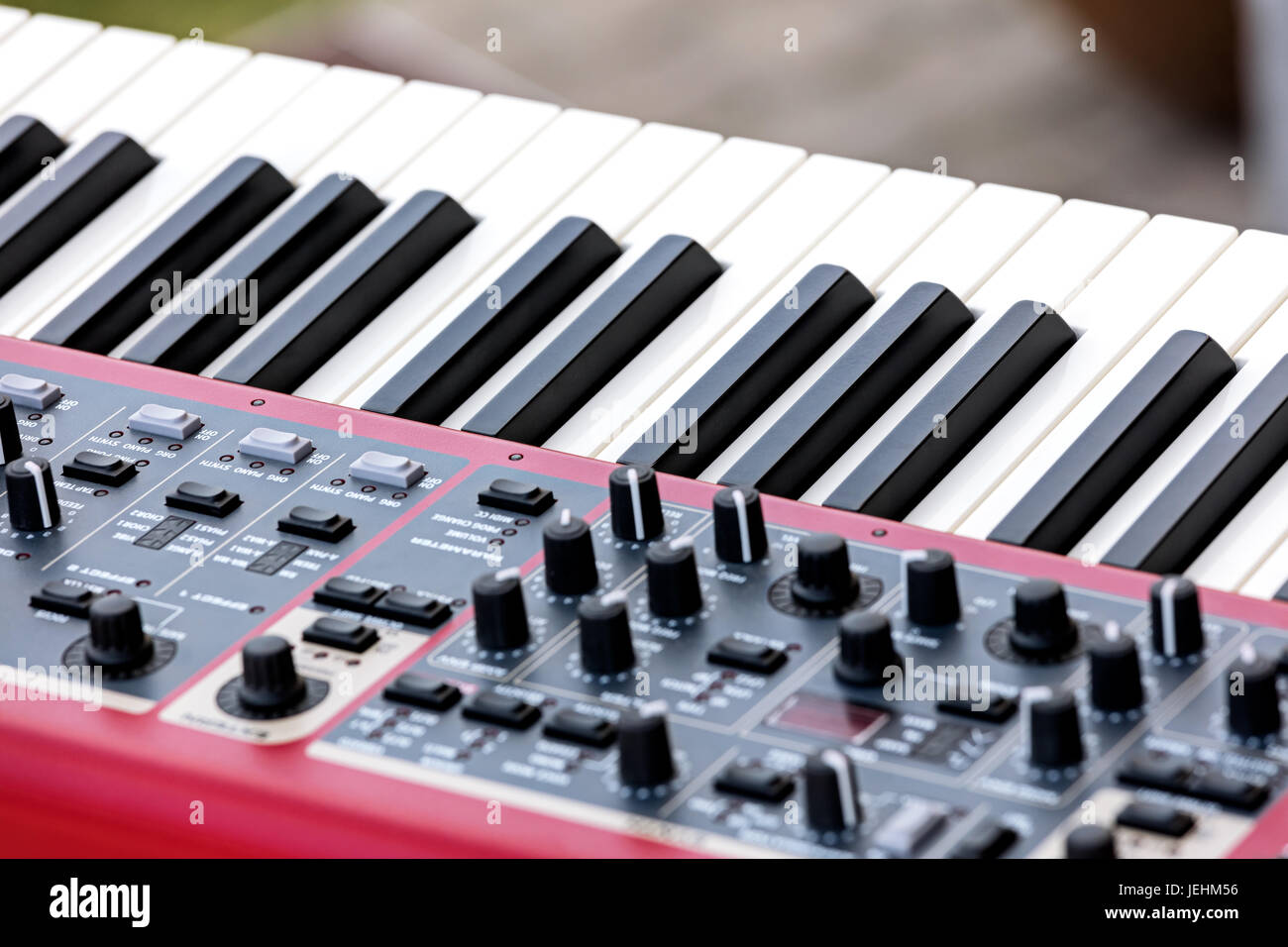 electronic synthesizer with keys, midi controller volume fader, knobs and sliders - Stock Image