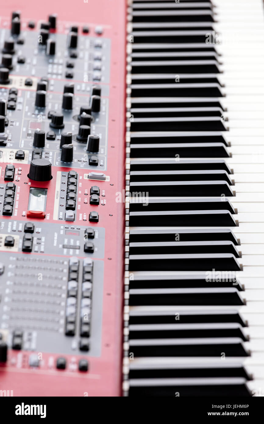 professional midi keyboard synthesizer with knobs and sliders. side view. - Stock Image