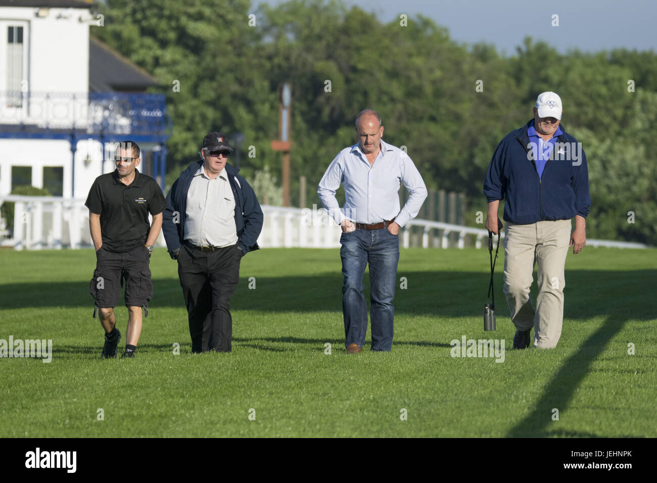 Trainer Kenny McPeek puts Investec Oaks contender racehorse 'Daddys Lil Darling' through her paces on the Epsom Downs racecourse track.  Featuring: Kenny McPeek Where: Epsom, United Kingdom When: 26 May 2017 Stock Photo