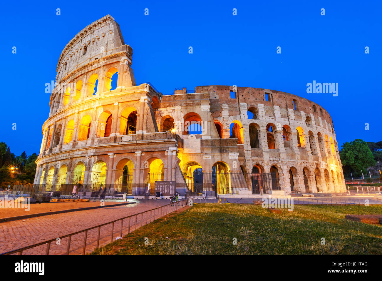 Night view of the Colosseum, an elliptical amphitheatre in the centre of Rome,Italy.Built of concrete and stone,it - Stock Image