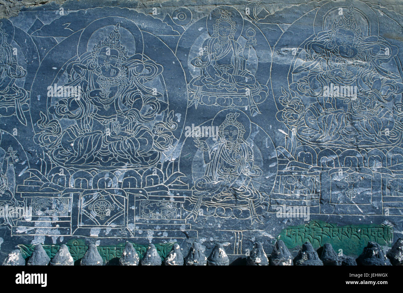 Nepal, Annapurna Region, Stone engraved with mantra and Buddhist deities. - Stock Image