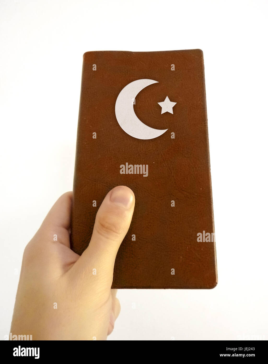 Hand Holding Islamic Book - Stock Image