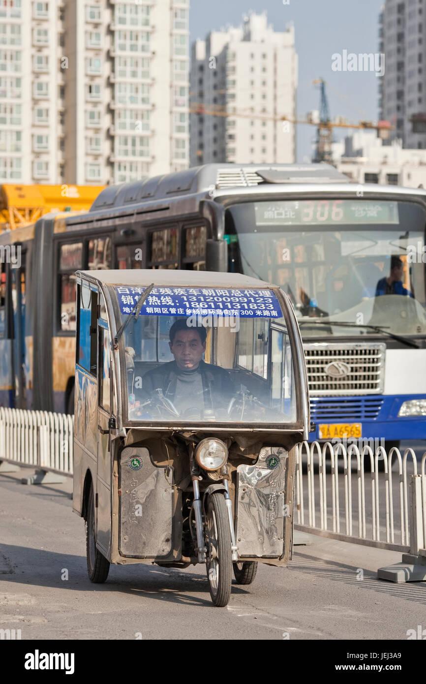 BEIJING–MARCH 27, 2012. Three wheel taxi on March 27, 2012 in Beijing. Beside 70,000 legitimate cabs Beijing has - Stock Image