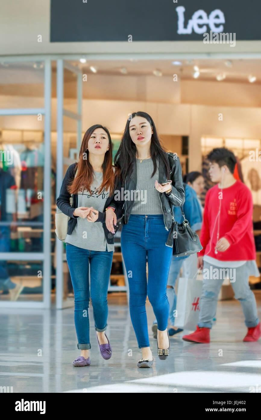 BEIJING-MAY 15, 2016. Fashionable girls at Lee outlet. Levi's and Lee remain the top two denim brands in China for - Stock Image