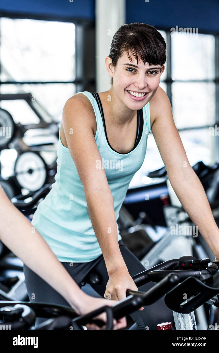 Fit woman working out at spinning class - Stock Image