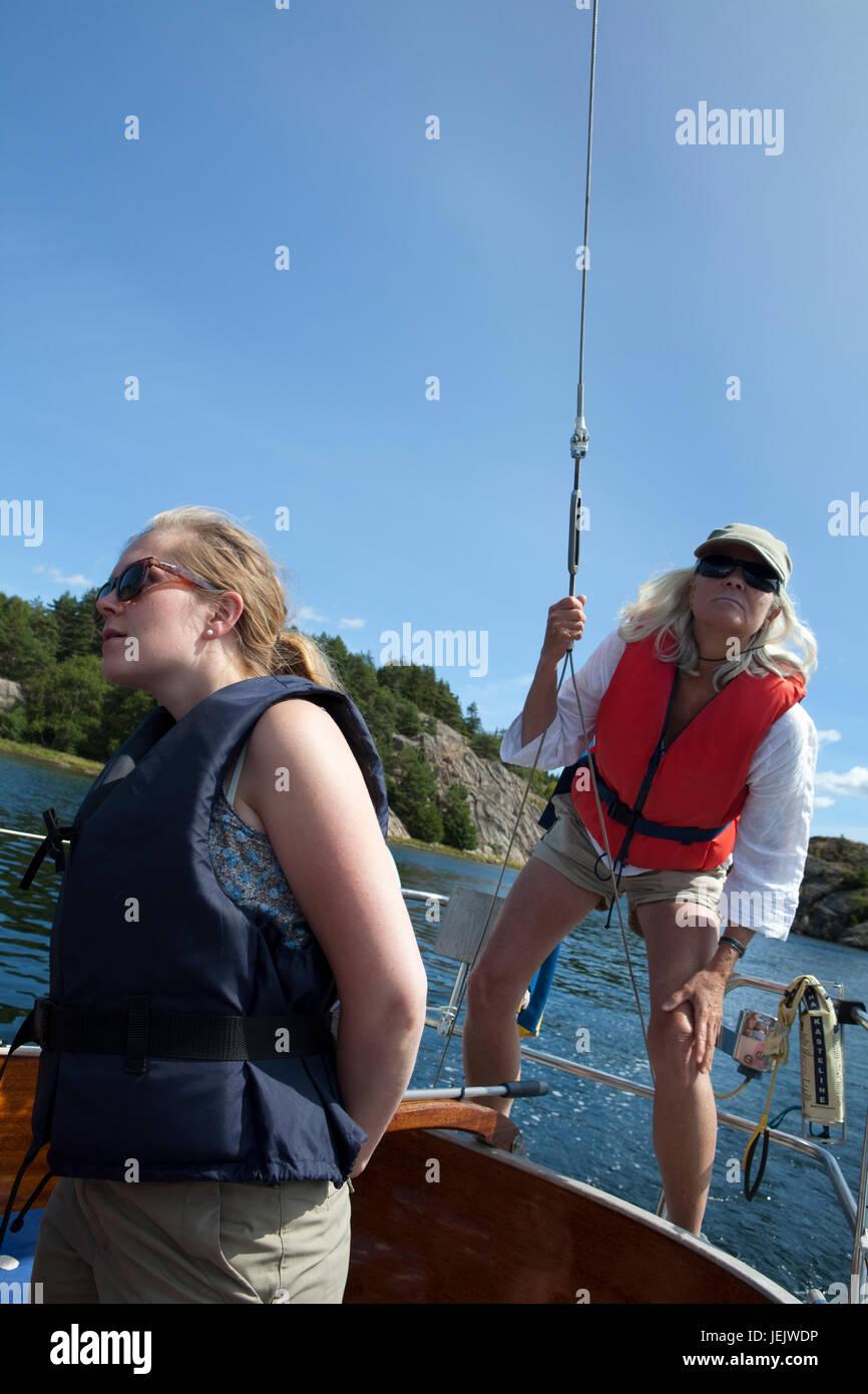 Women sailing on boat Stock Photo