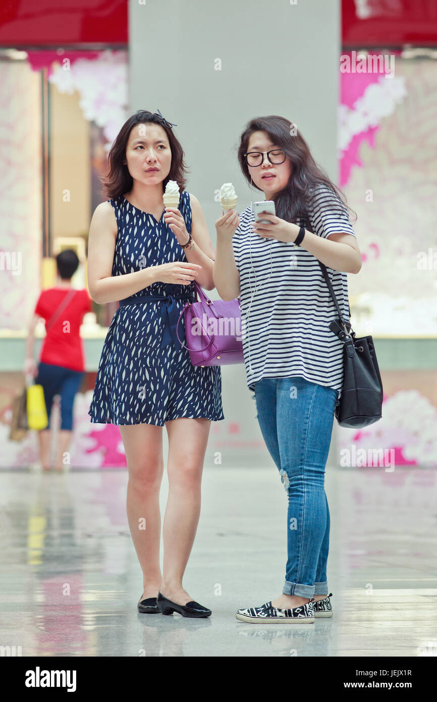 2 2015 Fashionable Girls In Shopping Mall First Generation One Child Policy Consumers Have Opposite Habits From Parents They