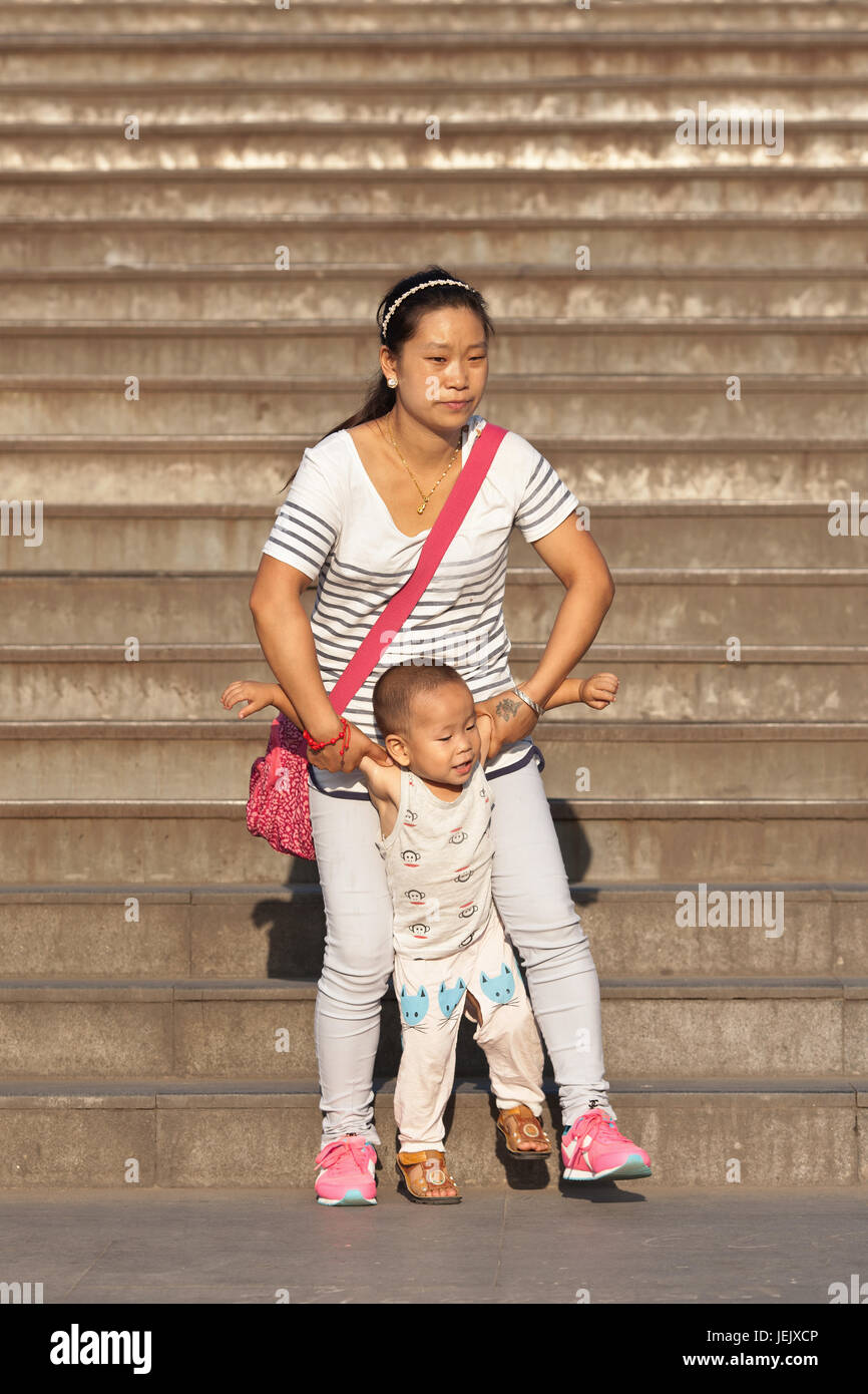 BEIJING-AUG. 27, 2015. Chinese woman with child. China's one-child policy, initiated late 1970s - early 1980s was - Stock Image
