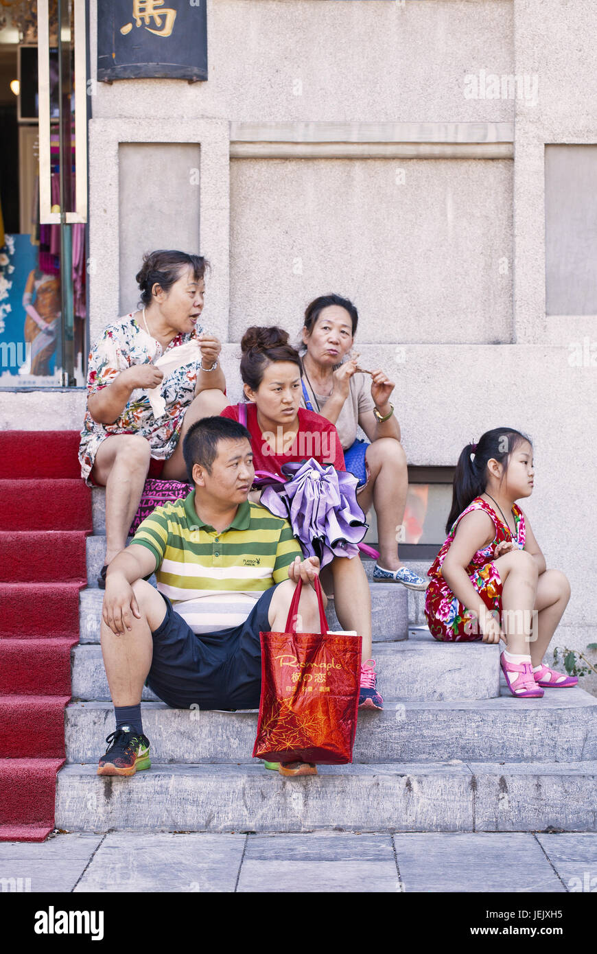 BEIJING-AUGUST 10, 2015. Chinese family having a break. Chinese are aware that family ties tend to looser in the - Stock Image
