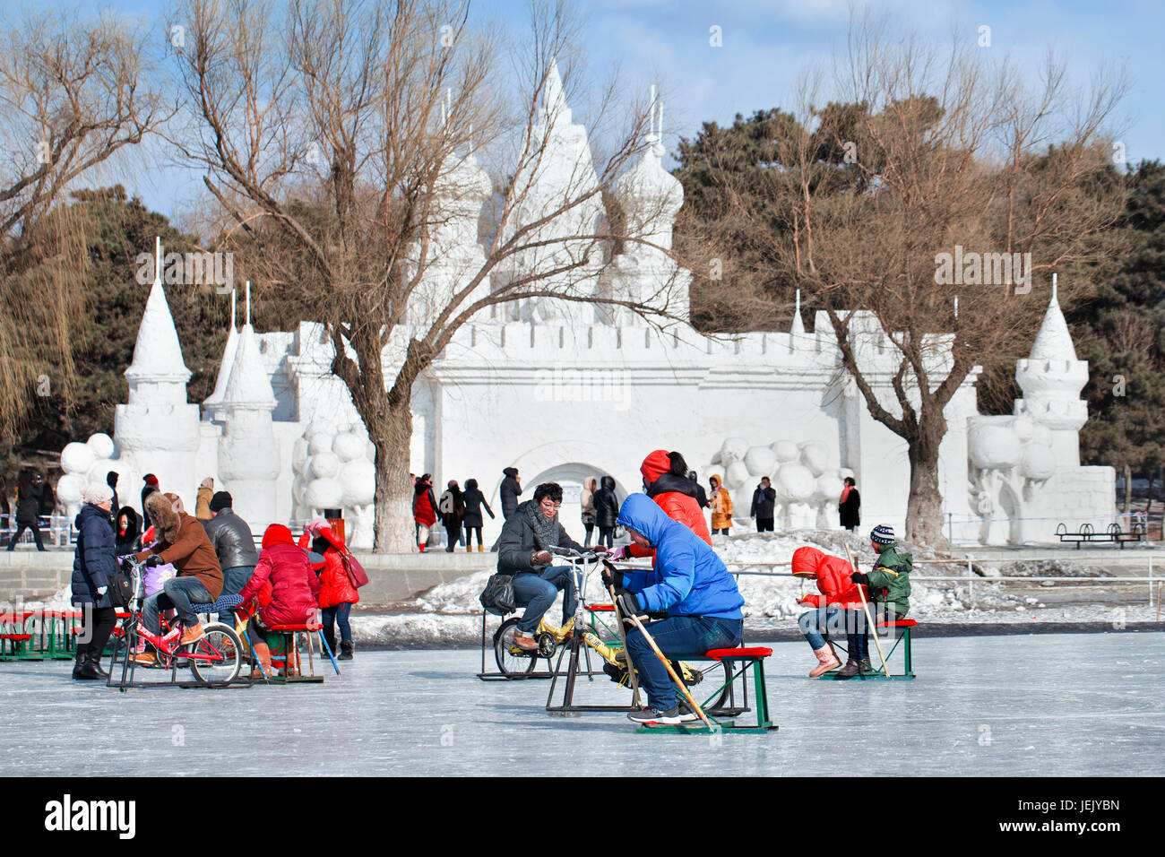 CHANGCHUN – FEBR. 4, 2014. People have fun with sledging on the ice in Nanhu Park Changchun, capital of northeast - Stock Image