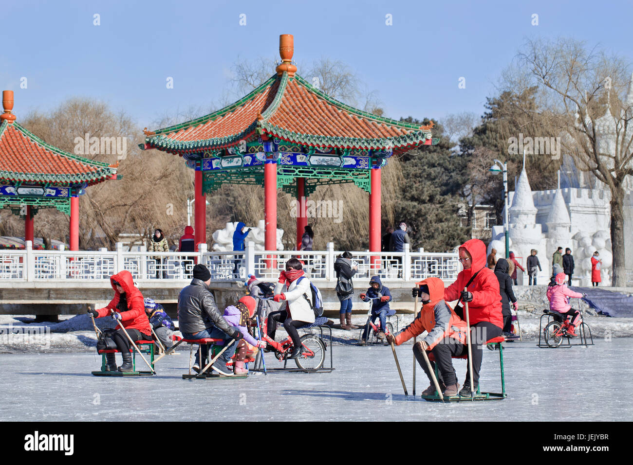 CHANGCHUN – FEB. 4, 2014. People have fun on the ice in Nanhu Park Changchun, capital of northeast Jilin Province. - Stock Image