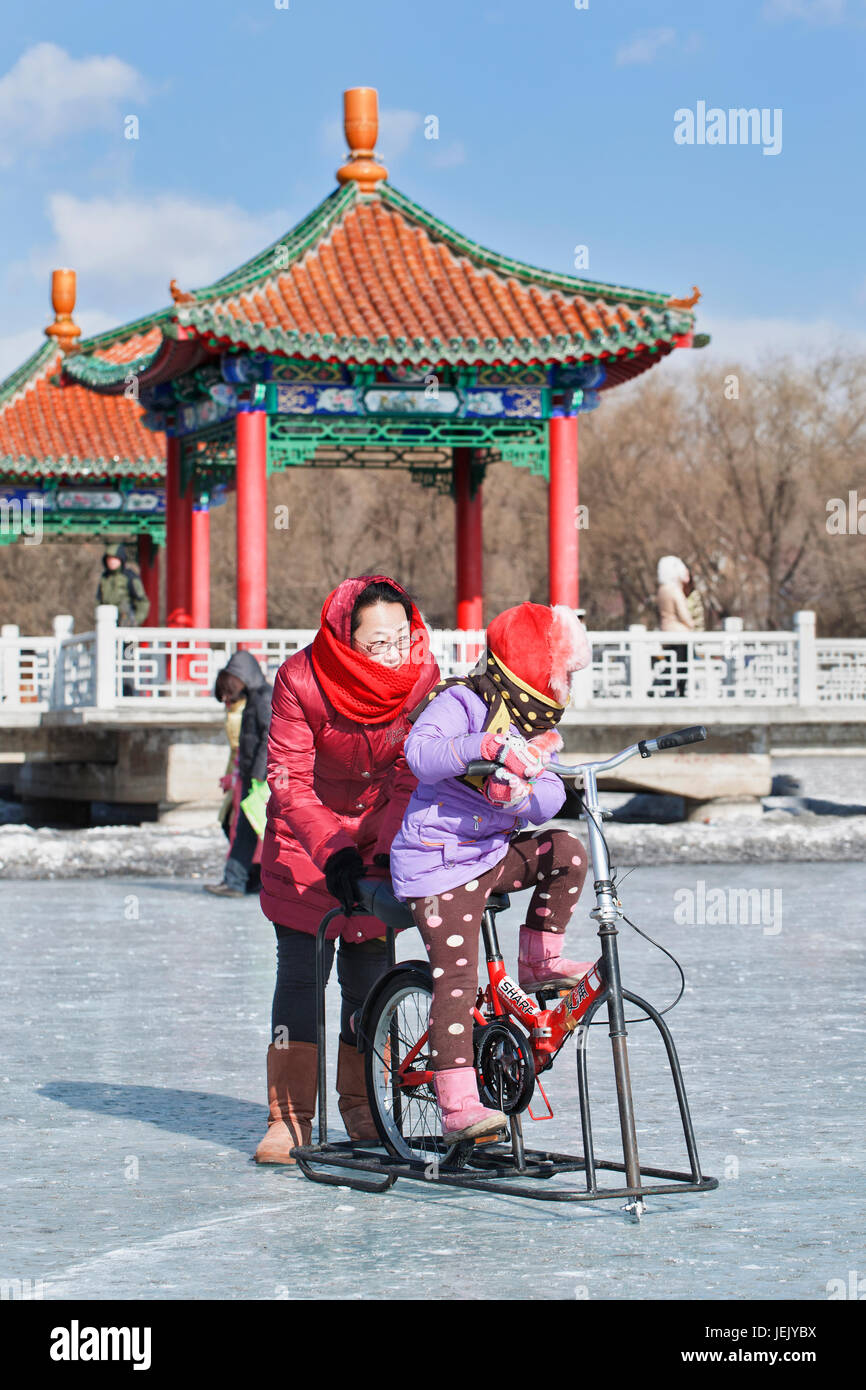 CHANGCHUN – FEBR. 4, 2014. People have fun on the ice in Nanhu Park Changchun, capital of northeast Jilin Province. - Stock Image