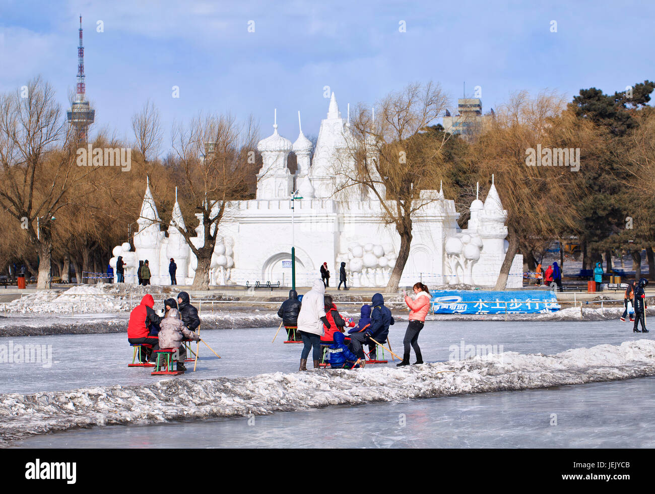 CHANGCHUN – FEB. 4, 2014. People have fun with sledging on the ice in Nanhu Park Changchun, capital of northeast - Stock Image
