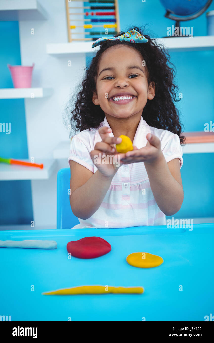 Cute girl using modeling clay Stock Photo