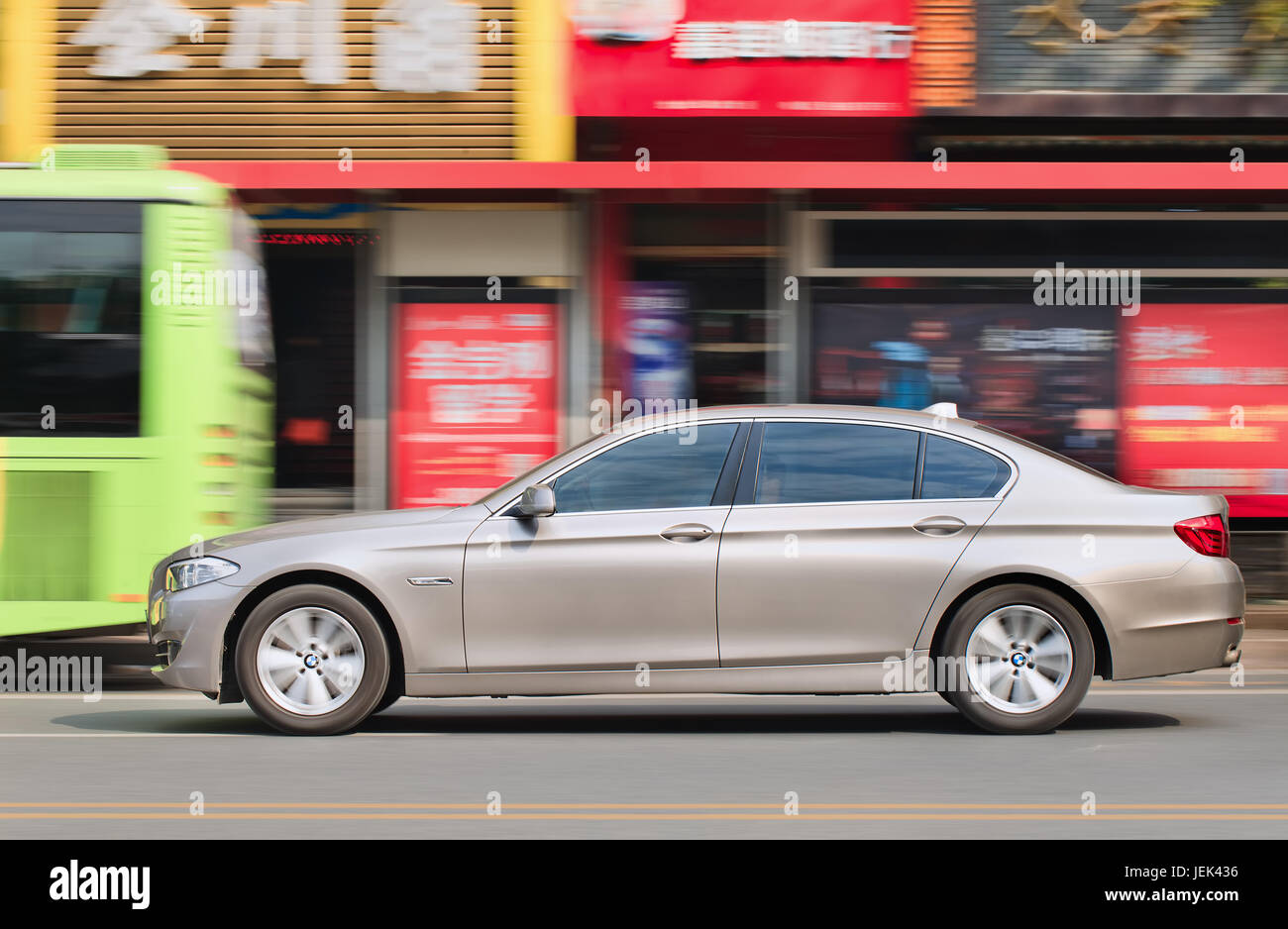 WENZHOU-CHINA-NOV. 19, 2014. BMW 5L series on the street. German Audi, BMW and Mercedes-Benz maintain a solid grip - Stock Image