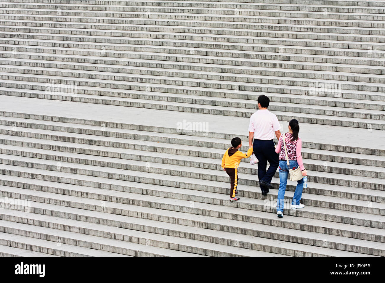 XIAN-MAY 22, 2009. A family's way up on a staircase. Since 1979 China's government retains a one-child policy but - Stock Image