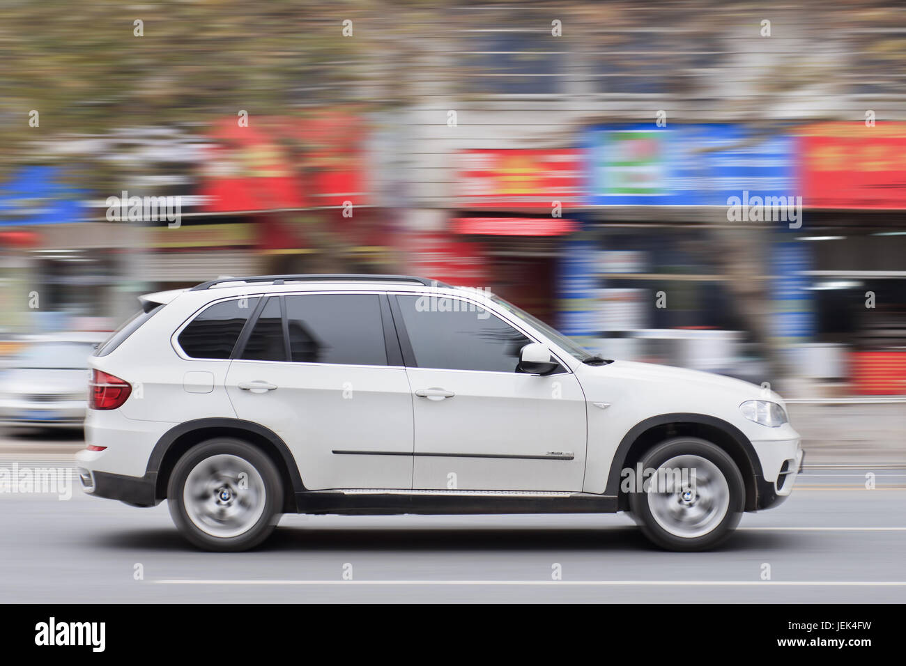 YIWU-CHINA-JANUARY 20, 2016. BMW X5 3.5i on the road. BMW sales will be hit in 2016 by cut-throat competition and - Stock Image