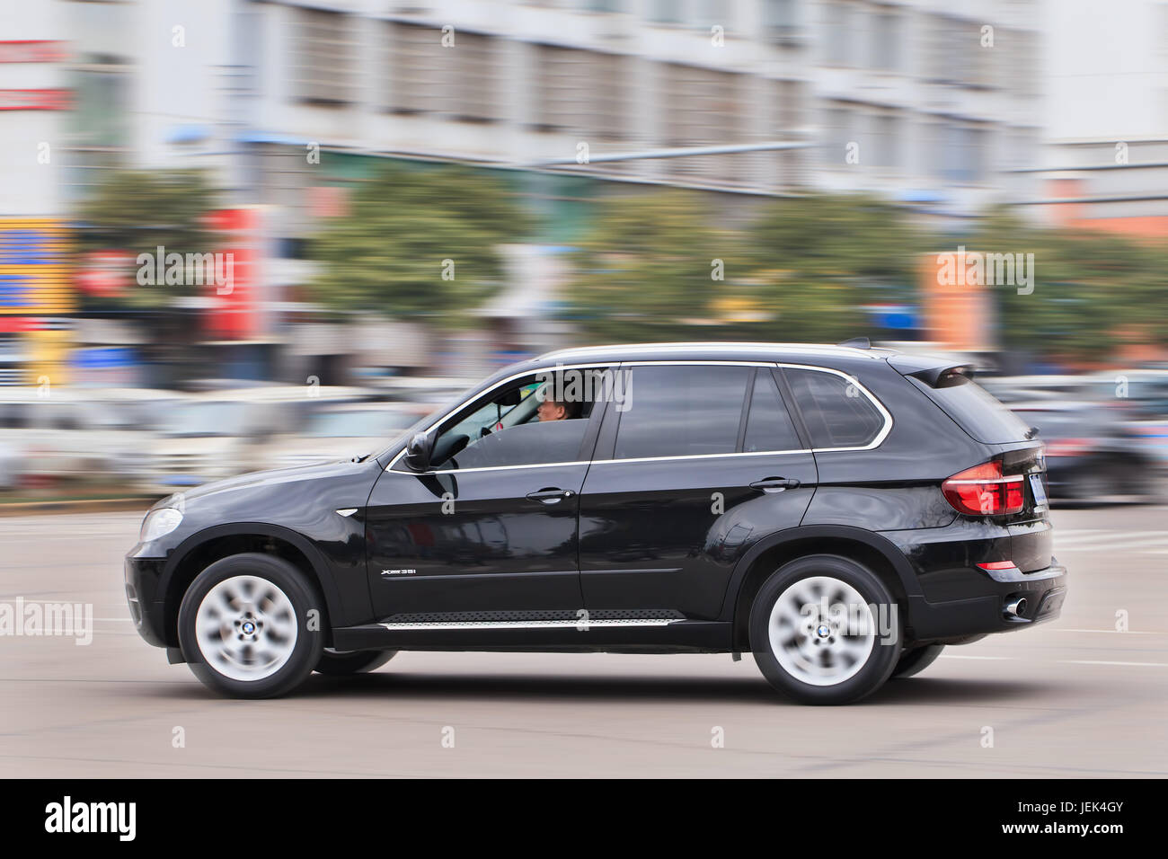 BMW X5 3.5i on the road. BMW sales will be hit by cut-throat competition, slowing Chinese economy and government - Stock Image