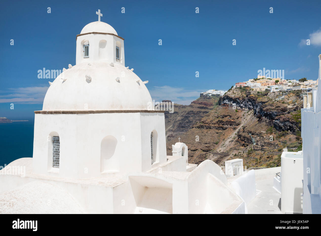 White cupola of church with Firostefani and Imerovigli villages in background, Santorini, Greece - Stock Image