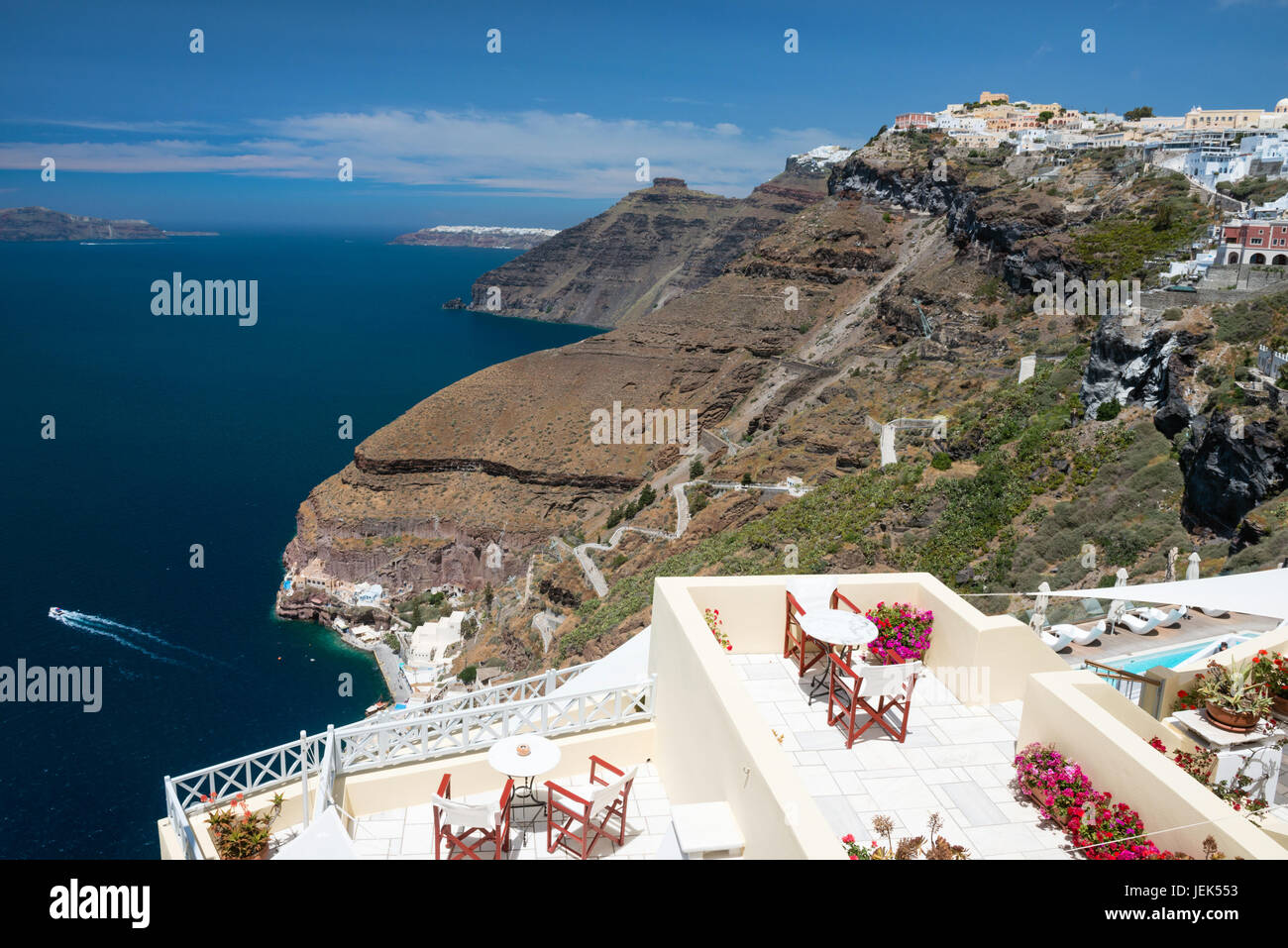 White cupola of church with Aegean sea and volcanic island in background, Santorini, Greece - Stock Image