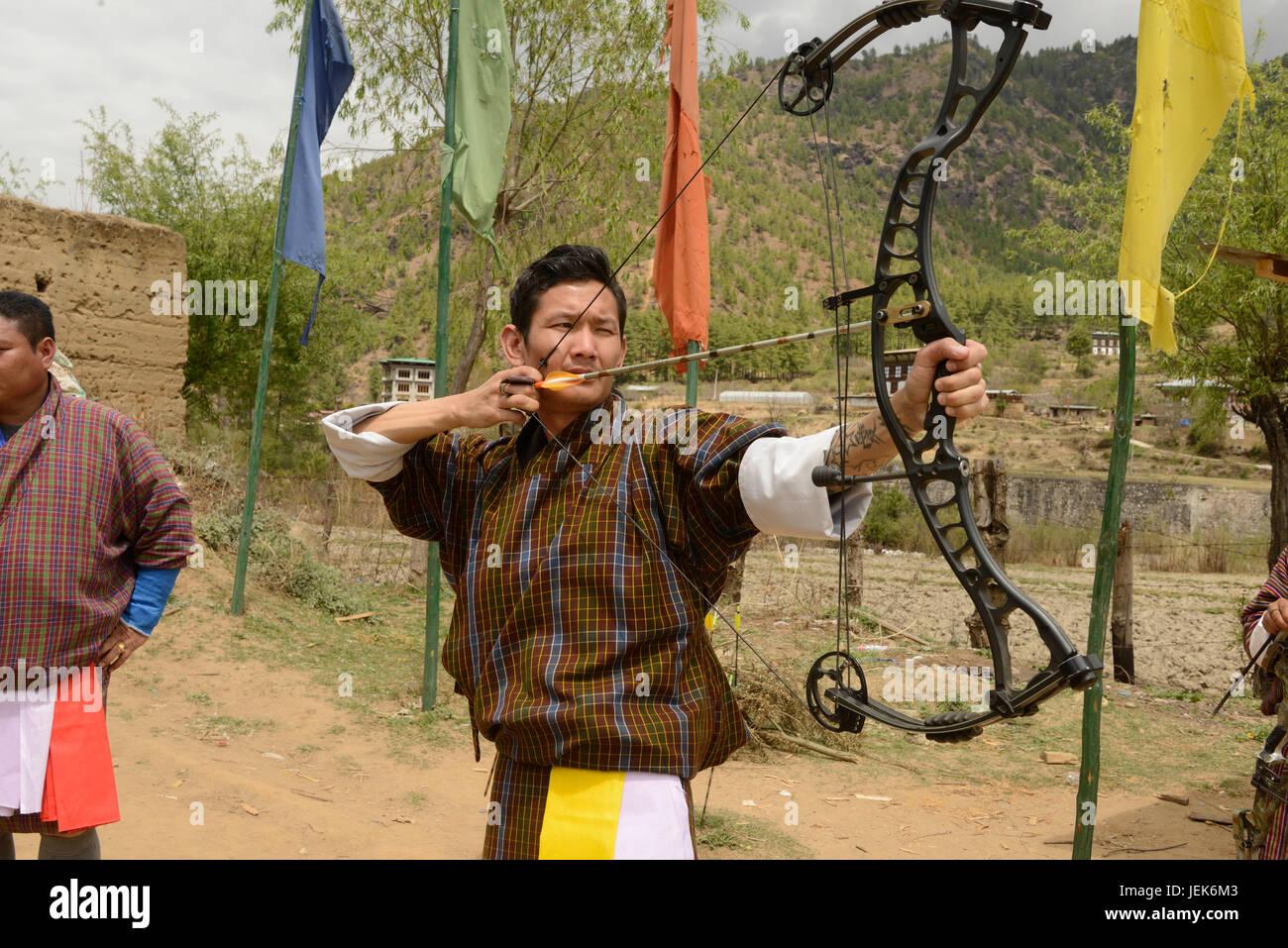 Man practicing national sport of archery, Thimphu, Bhutan, asia - Stock Image