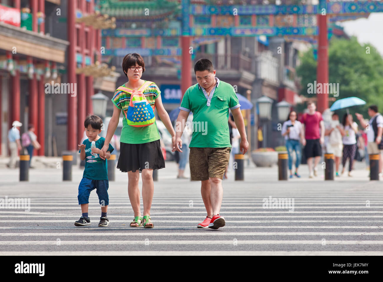 BEIJING-JUNE 9, 2015. Chinese couple with child. China's one-child policy, initiated late 1970s - early 1980s was - Stock Image