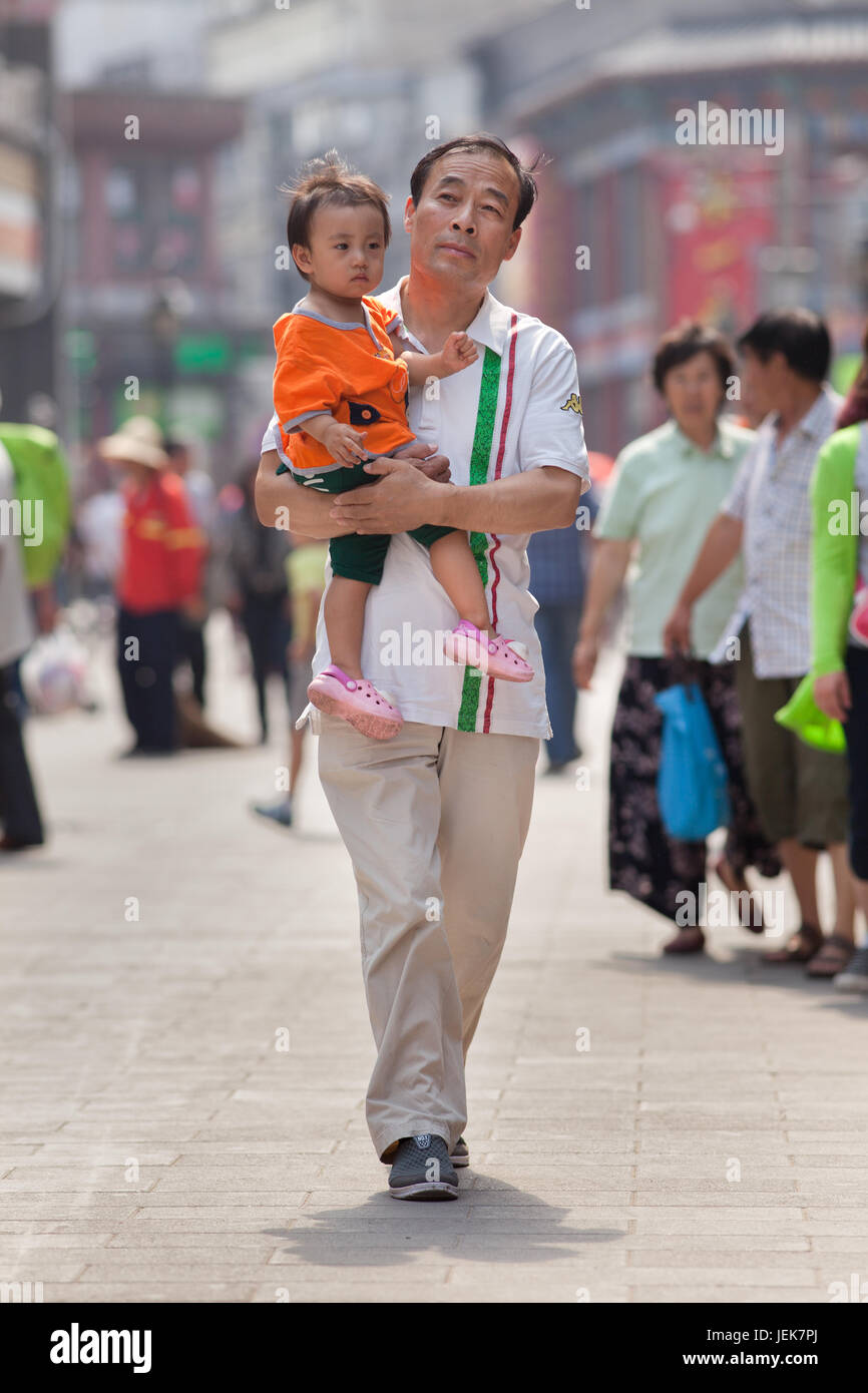 BEIJING-JUNE 9, 2015. Chinese father with child. China's one-child policy, initiated late 1970s - early 1980s was - Stock Image