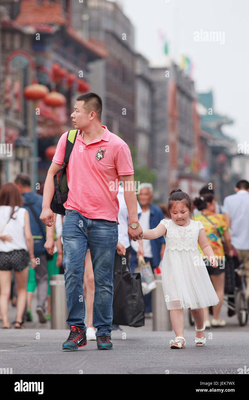BEIJING-JUNE 9, 2015. Chinese man with child. China's one-child policy, initiated late 1970s - early 1980s was to - Stock Image