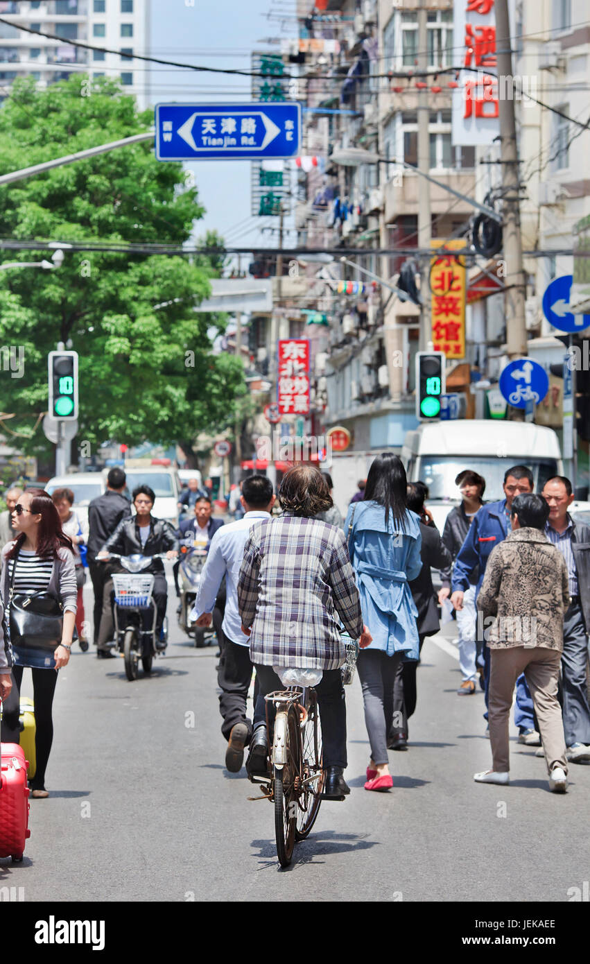 SHANGHAI-MAY 5, 2014. City dwellers on the street in a dense area. Urban densities average around 40,000 residents - Stock Image