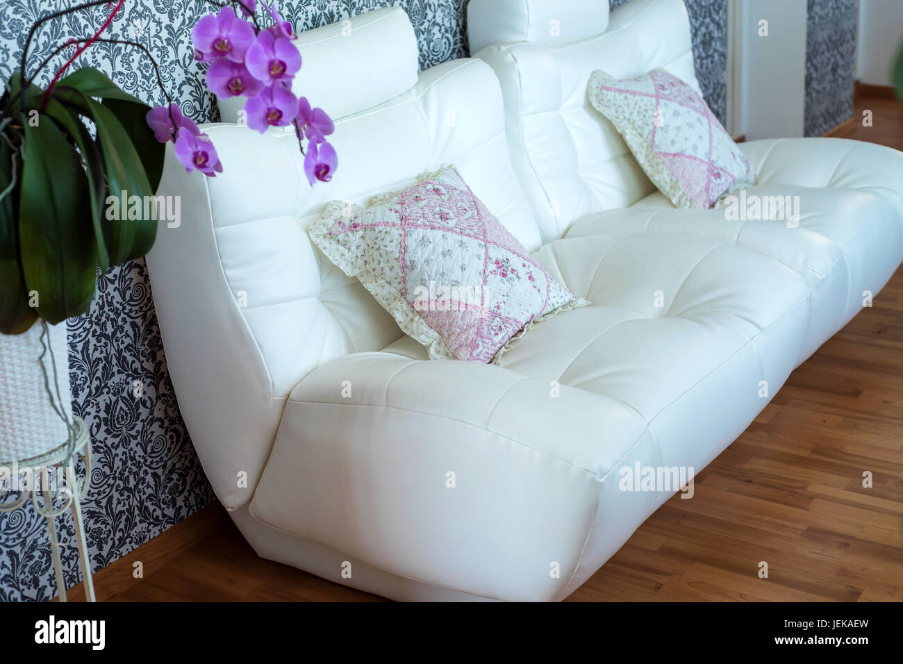 Modern cozy white leather sofa in room Stock Photo