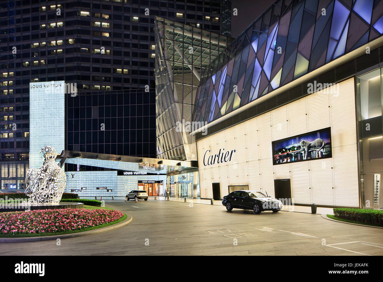 SHANGHAI–JUNE 4, 2014. Louis Vuitton and Cartier outlet. While most of the world cut down spending, Chinese consumers - Stock Image