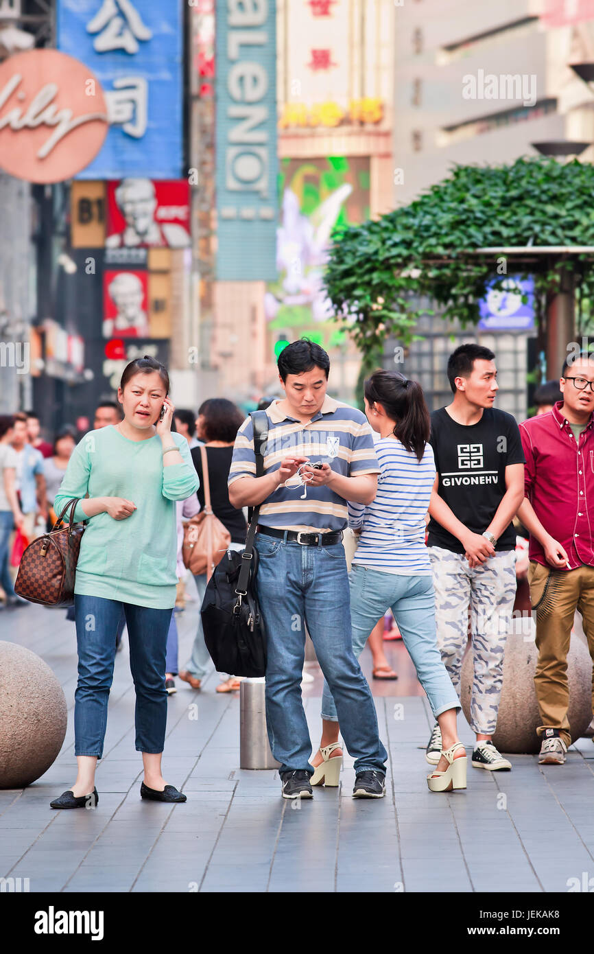 People busy with their smartphone. In 2015 China has 574.2 million smartphone users,  But in 2018, more than half - Stock Image