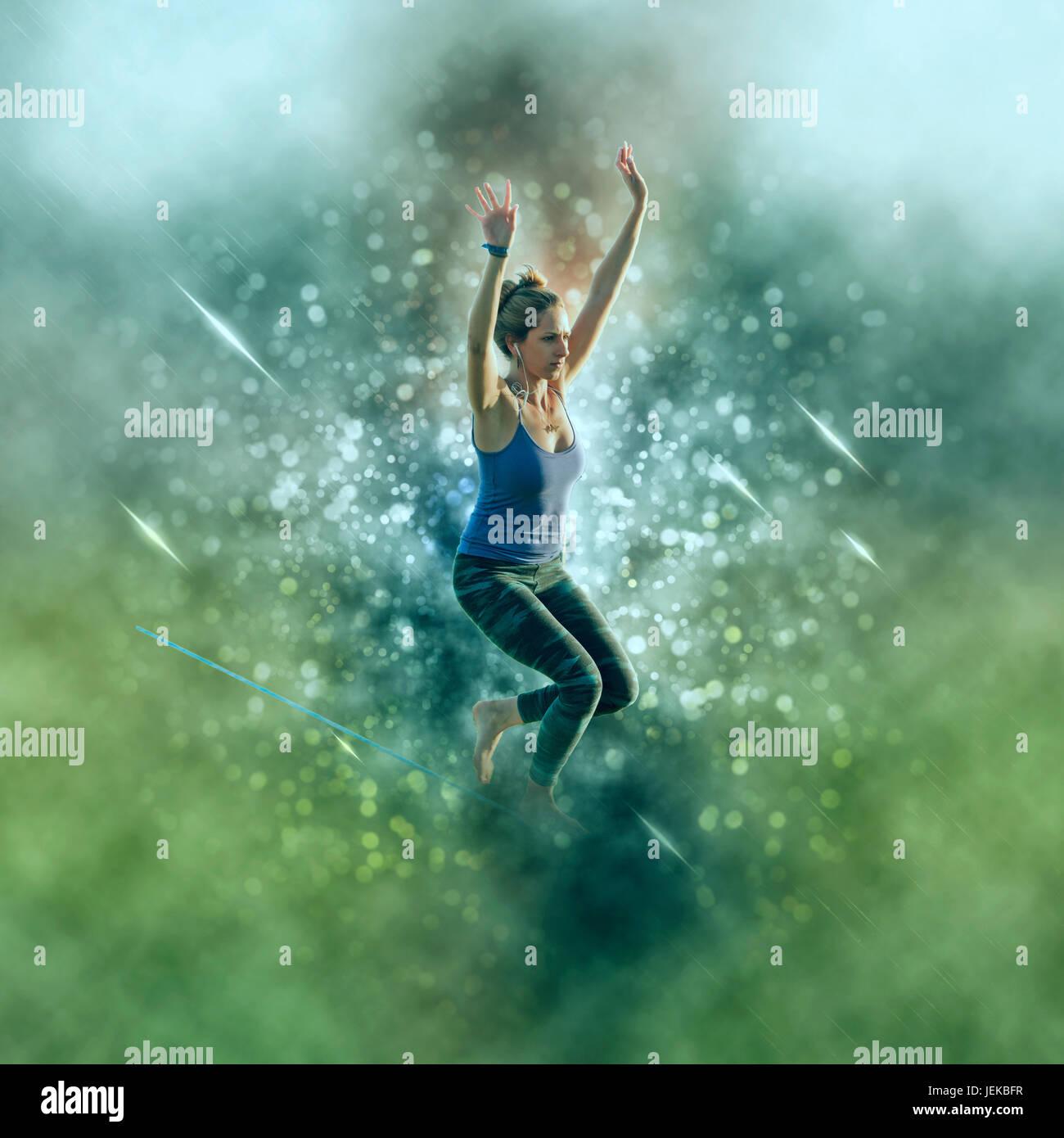 Digitally enhanced image of a woman Slacklining - Stock Image