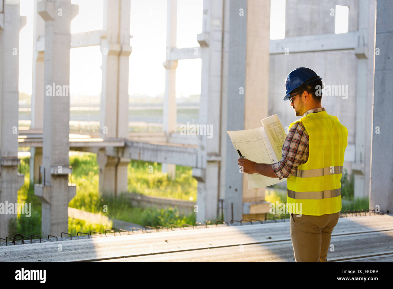 Picture of construction site engineer looking at construction plan - Stock Image
