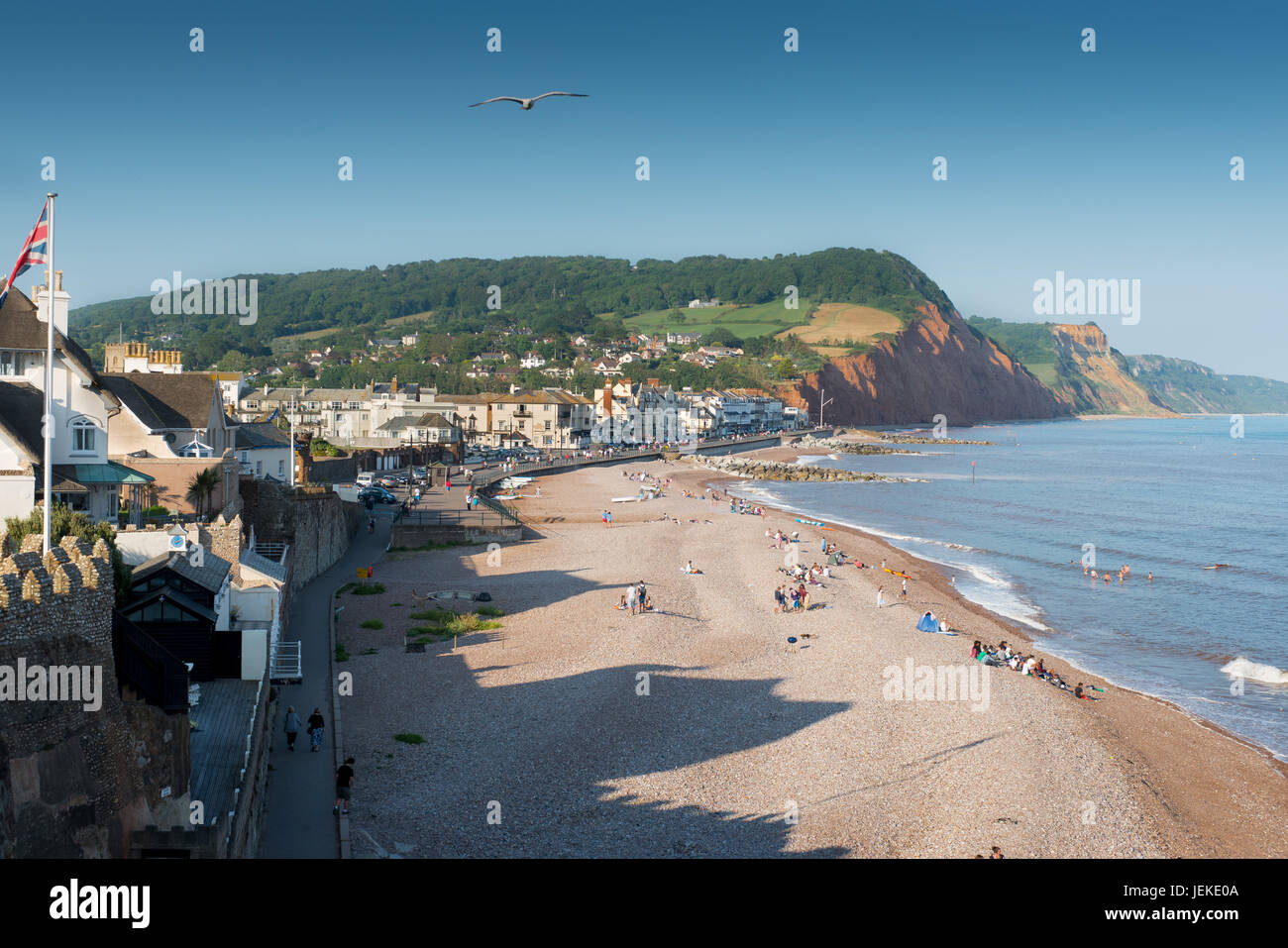 Pic by Guy Newman. 15.07.2013. The evening sun falls on Sidmouth beach in Devon. - Stock Image