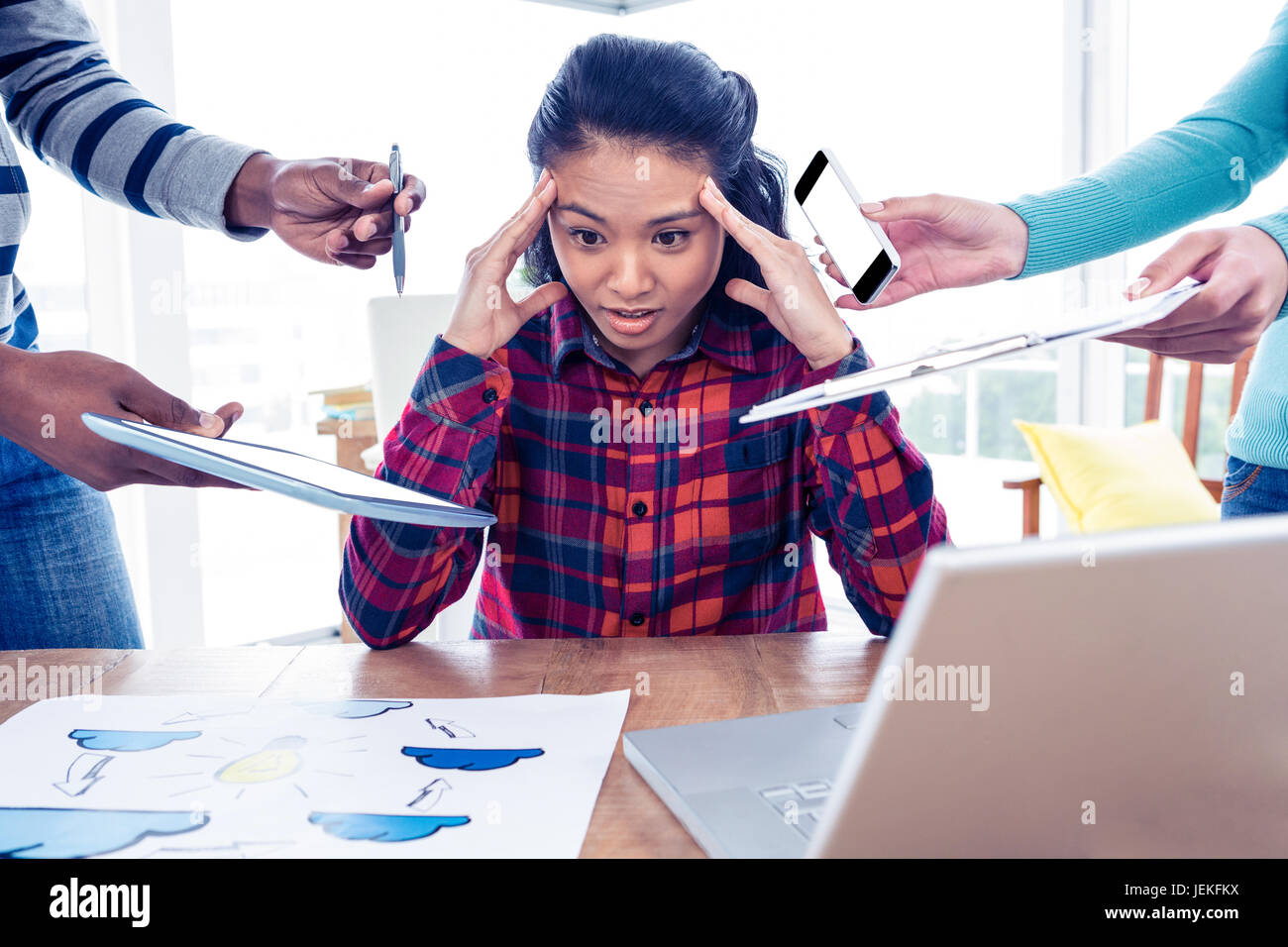 Stressful businesswoman looking down Stock Photo