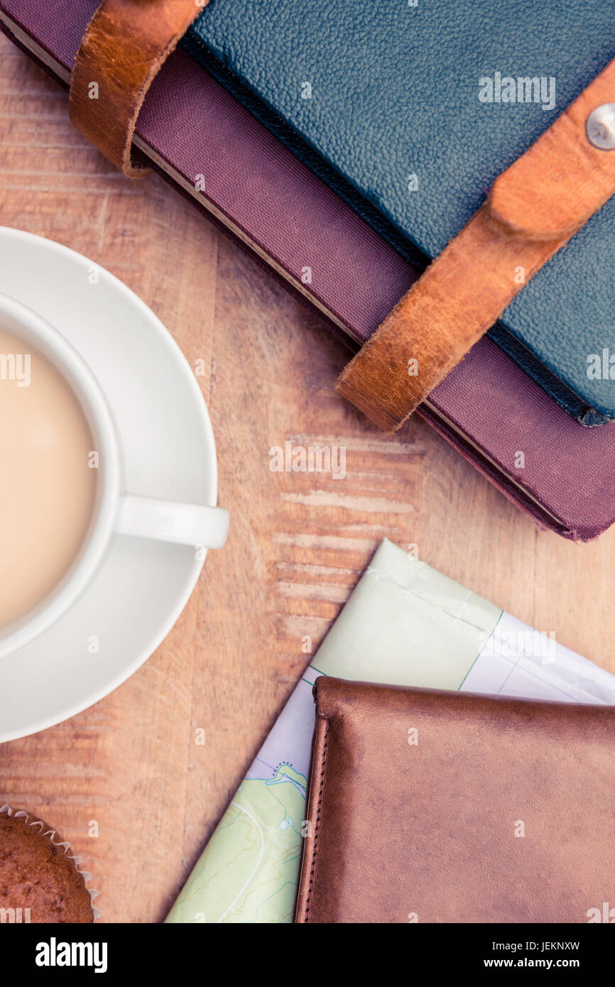 Close-up of coffee with wallet and diaries - Stock Image