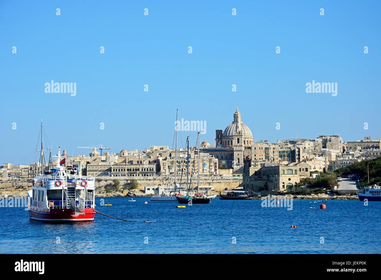 View of St Pauls Anglican Cathedral and the Basilica of Our Lady of Mount Carmel seen from the Grand Harbour, Valletta, Stock Photo