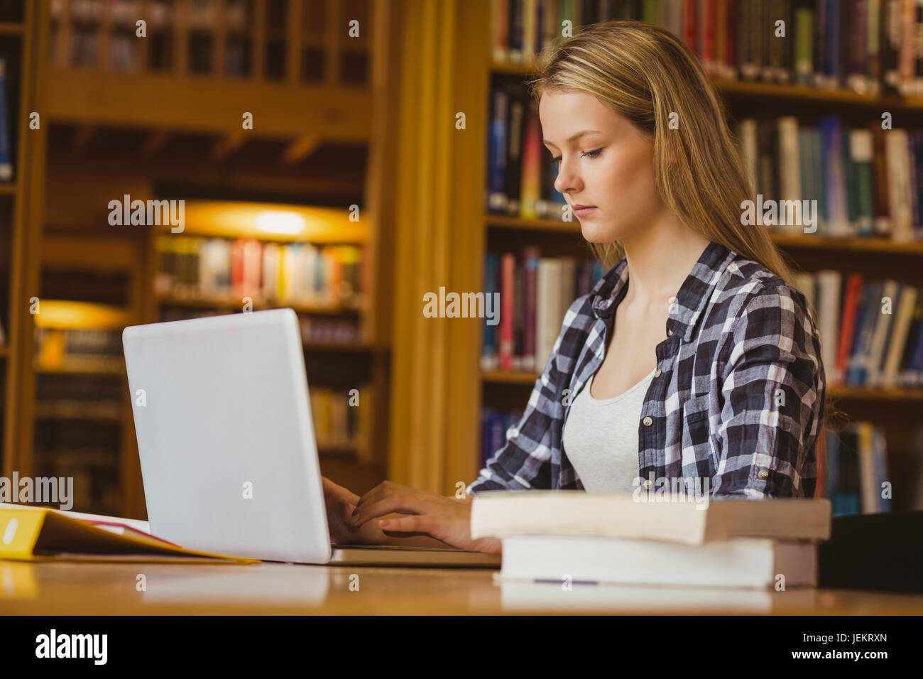 Serious student working on laptop - Stock Image
