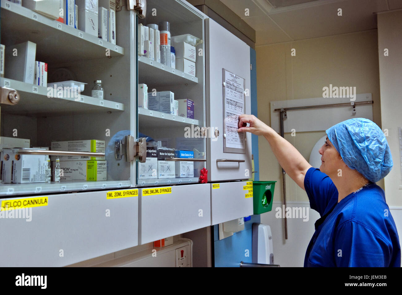 ODP Anaesthetics Practitioner checks surgical schedules. - Stock Image