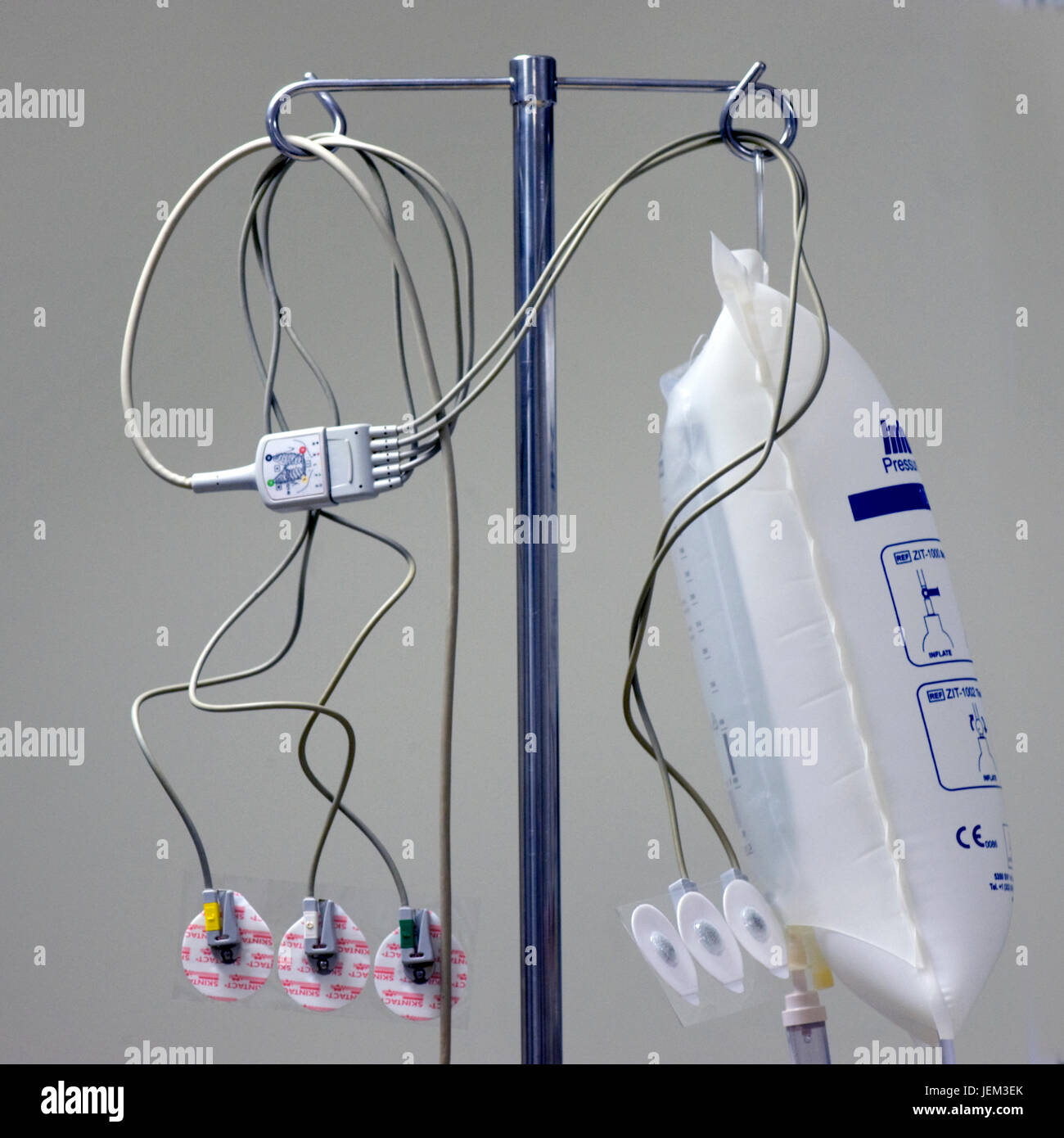 An IV pole or drip stand in an anaesthetics room in readiness for use anaethsetising a patient for a surgical operation. - Stock Image