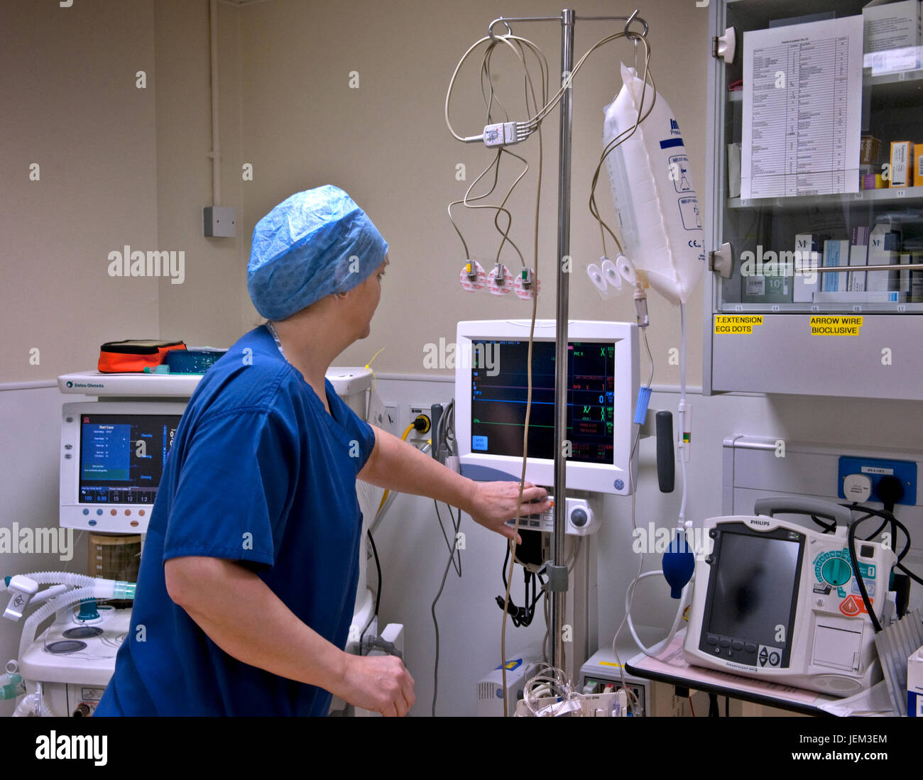Before a hospital surgical session, an ODP anaesthetics practitioner prepares and checks correct functioning an - Stock Image