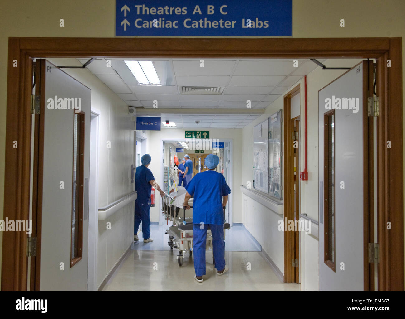 A patient is taken for a cardiac operation in a hospital operating suite. - Stock Image