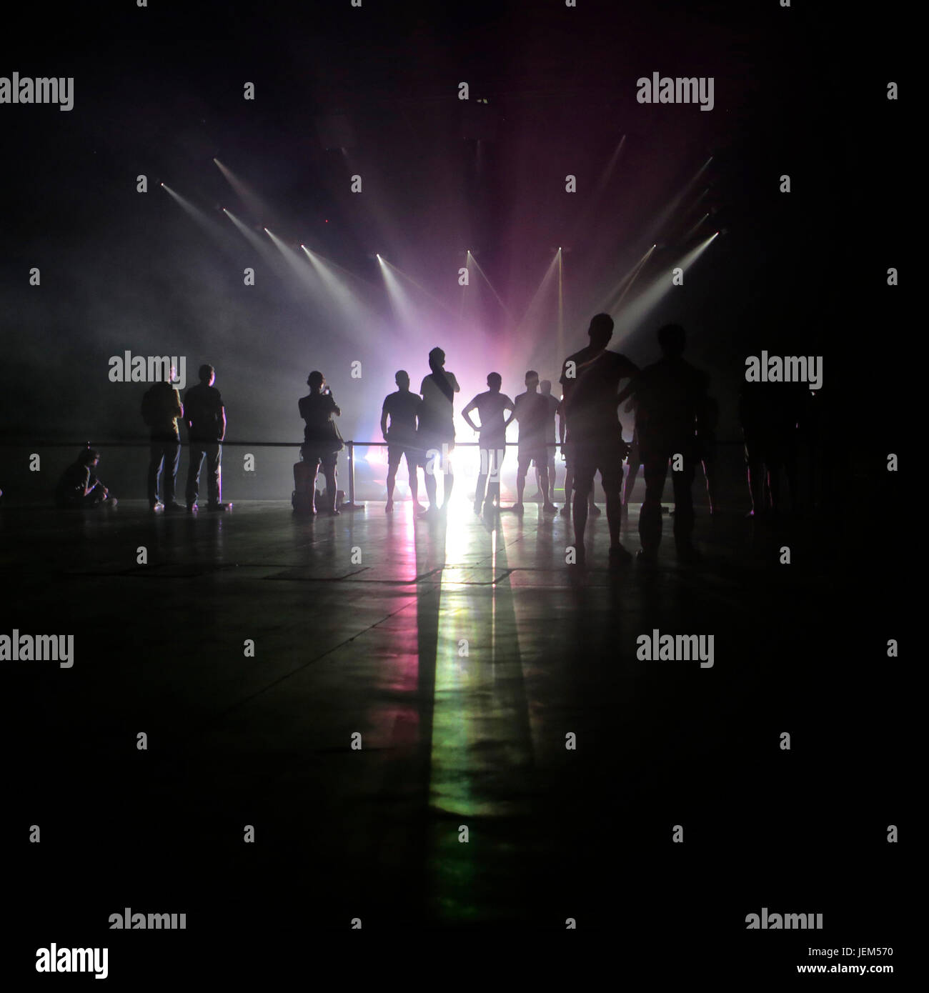 People watching a light spectacle by Daito Manabe - Stock Image