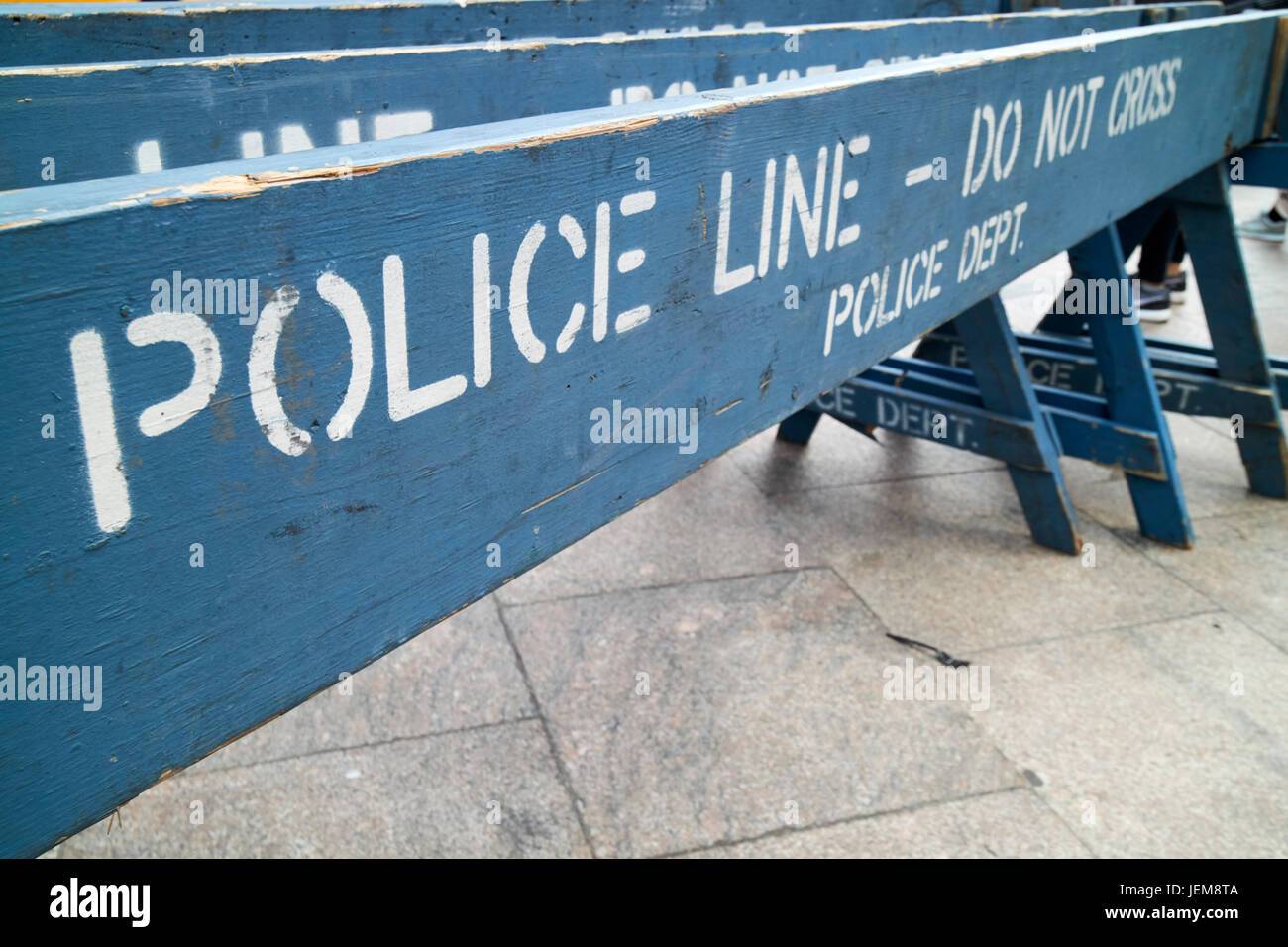 blue wooden police line do not cross nypd crowd traffic barrier New York City USA - Stock Image